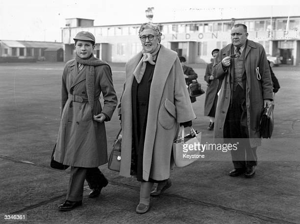 English crime writer Agatha Christie at London Airport with her grandson Matthew Pritchard