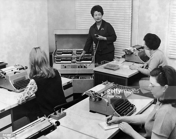Mrs Lane Principal of the first Margery Hurst College for Administrative and Secretarial Duties in London uses Phillips stenolab equipment to train a...