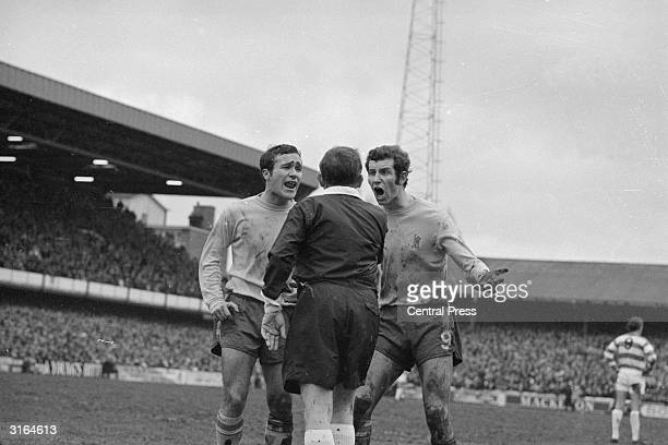 Chelsea captain Ron Harris and centre forward Peter Osgood protesting to the referee K Howley of Teeside after a penalty kick was ordered to be...