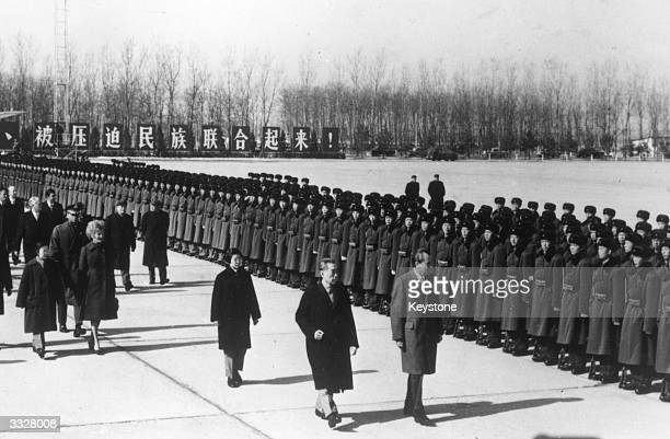 American president RIchard Nixon inspecting a guard of honour at Peking airport with Chinese president Chou En Lai