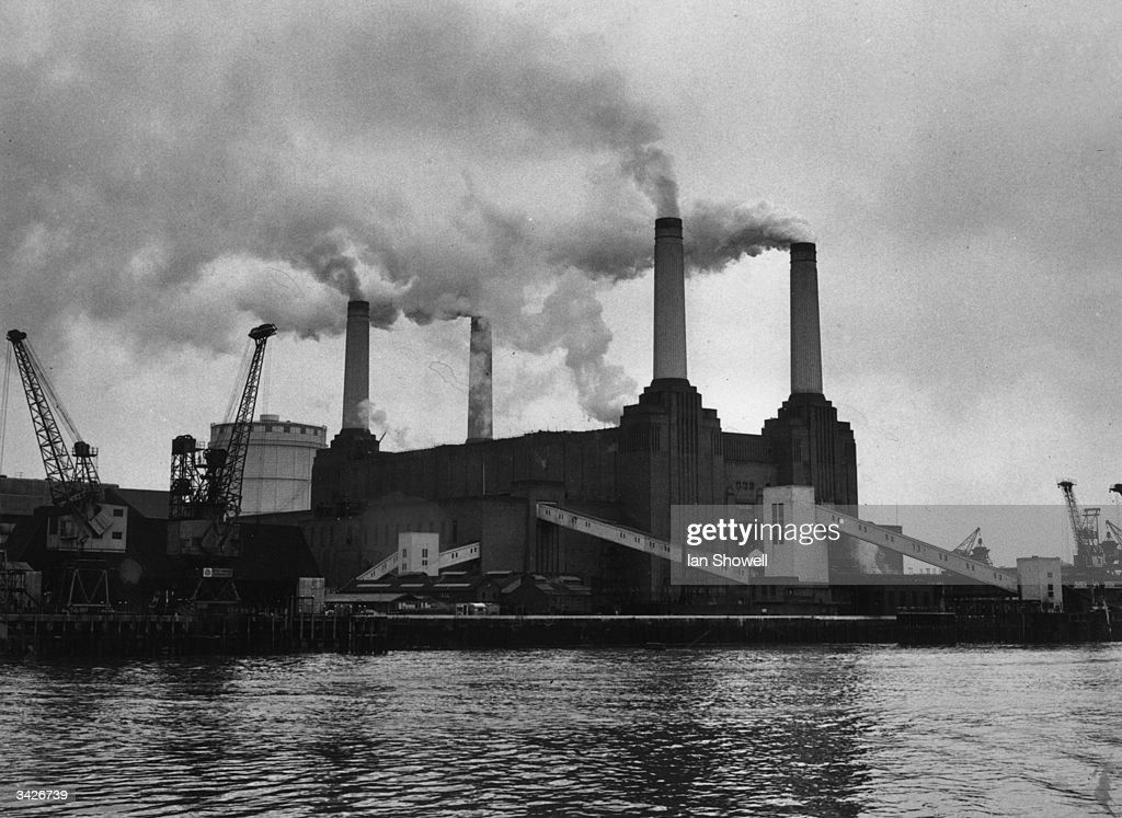 The Gothicstyle towers of Battersea Power Station on the bank of the River Thames Designed by leading architect Giles Scott the impressive building...