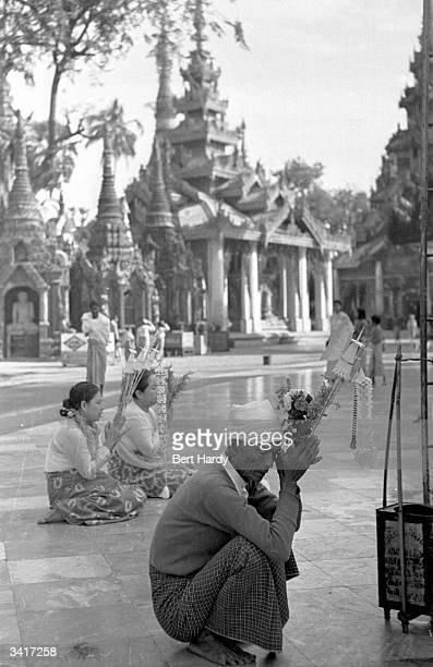 A Buddhist pilgrim praying at the Great Shwe Dagon Pagoda Original Publication Picture Post 4748 Inside The Temples Of Burma pub 1950