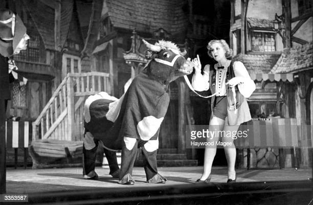 Talking to a pantomime cow actress Dorothy Ward as the principal boy in the pantomime 'Jack and the Beanstalk' at the Chiswick Empire Original...