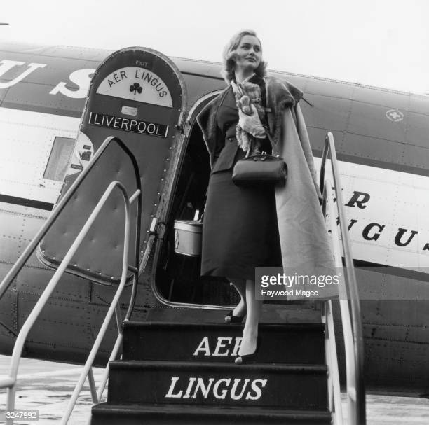 Beauty queen Stephanie Howell the StaBlond Queen of 'Fairheads' returns from Ireland on an Aer Lingus plane after a round of personal appearances...