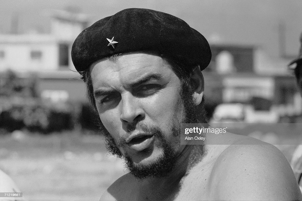 Stripped to the waist, Argentine-born revolutionary Ernesto <a gi-track='captionPersonalityLinkClicked' href=/galleries/search?phrase=Che+Guevara&family=editorial&specificpeople=67207 ng-click='$event.stopPropagation()'>Che Guevara</a> (1928 - 1967), who waged guerrilla warfare with the Castro brothers, helps workers on a low cost housing project near Havana. At that time he was the head of the Cuban National Bank as well as Minister of Industries.