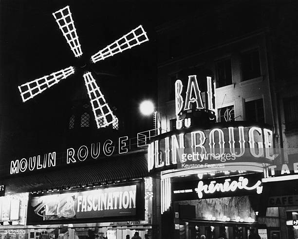 The neon lights of the famous Moulin Rouge nightclub in Paris which opened in 1890