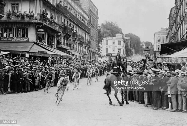 Ottavio Bottecchia of Italy chases Lucien Buysse of Belgium through St Cloud during the final stage of the 1925 Tour de France Bottecchia went on to...