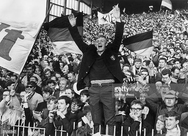 A West German fan celebrates his team's first goal in a World Cup match against Spain at Villa Park Birmingham West Germany won the match by 21