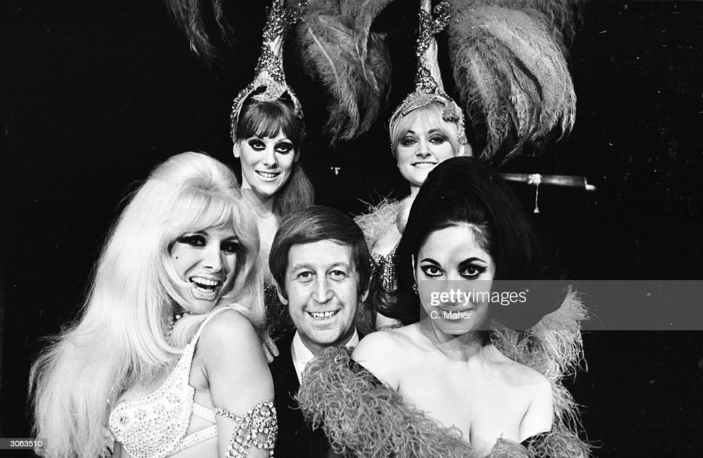 Club owner Paul Raymond and four of his revue dancers, who are on their way to Aden to entertain the troops. The dancers are Carole Ryva, Jean Crabtree, Lady Flan and Sandra Bunting.