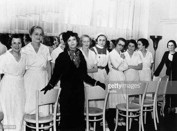 Beautician and businesswoman Elizabeth Arden with a group of nurses