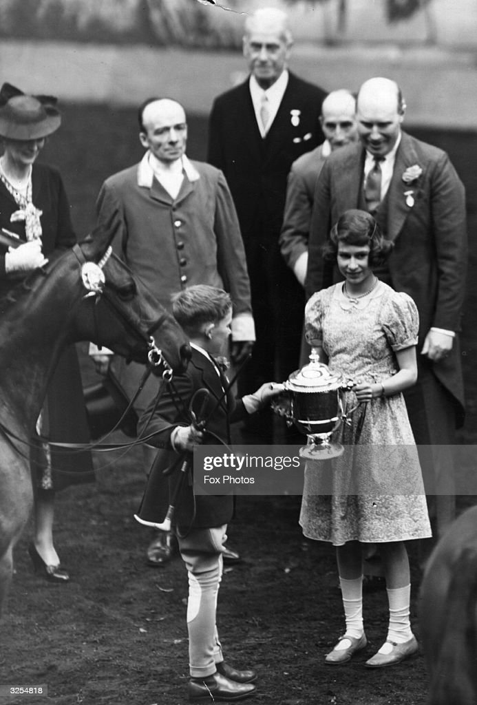 Princess Elizabeth and Princess Margaret (1930 - 2002) at the gala performance of the International Horse Show at Olympia, London.