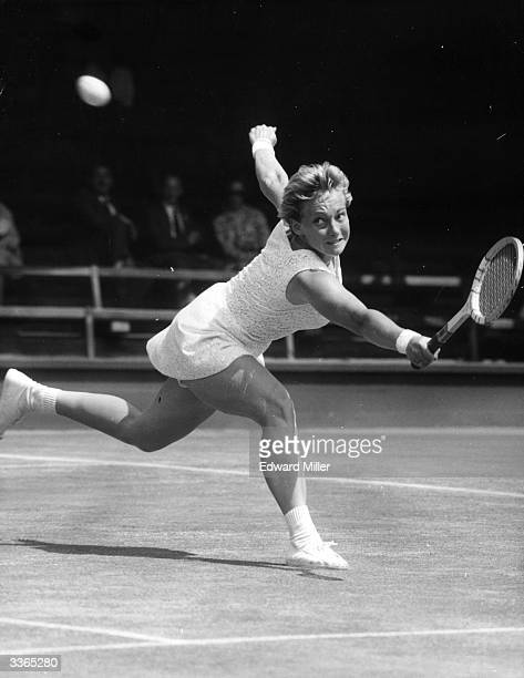 US tennis player Darlene Hard in action during a women's singles match at Wimbledon