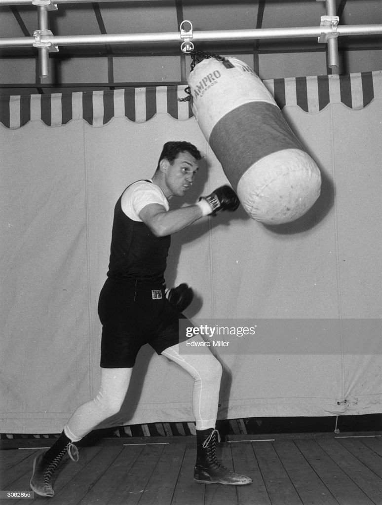 http://media.gettyimages.com/photos/21st-june-1961-american-boxer-paul-pender-during-a-training-session-picture-id3062855