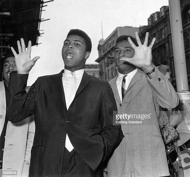American heavyweight boxer Cassius Clay with his brother Rudolph