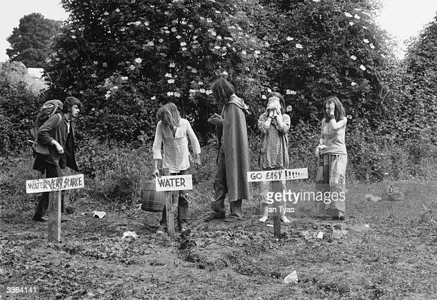 Festivalgoers washing and collecting water at one of the stand pipes at Glastonbury Festival The event at Worthy Farm in Pilton Somerset celebrates...