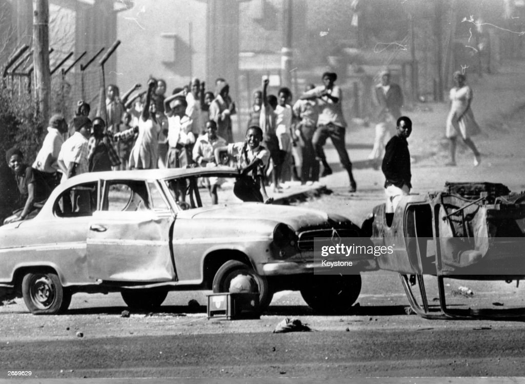 South African rioters in Soweto use cars as roadblocks during unrest stemming from protests against the use of Afrikaans in schools