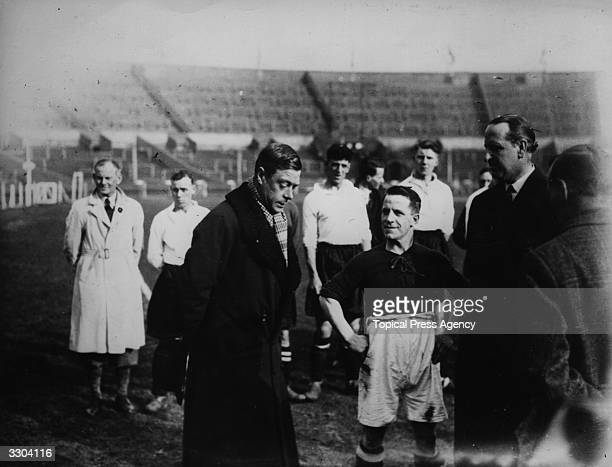 Edward Prince of Wales talks with the captain of one of the teams playing in the final of the London Occupational Football League Competition for...