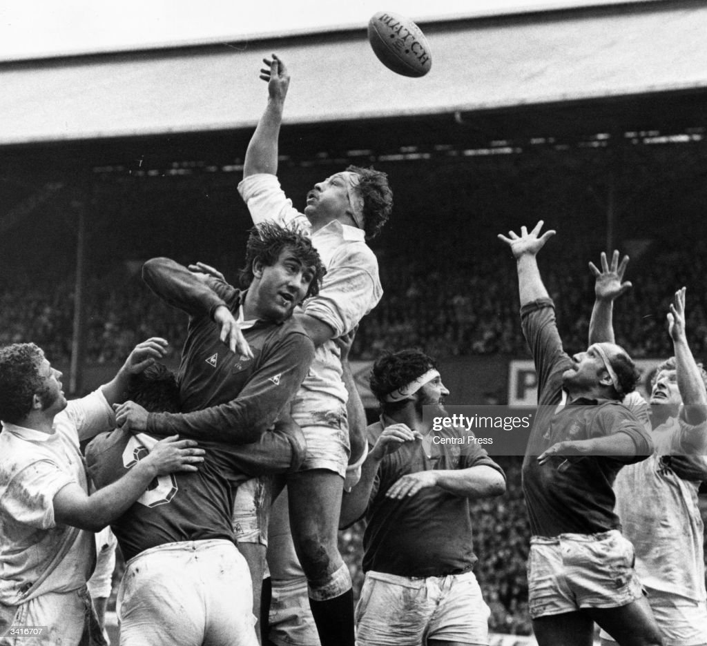 Players of both teams leap high in the air for the ball as England play France in a Rugby International at Twickenham. From left to right are : Phil Blakeway (England), Robert Paparemborde (France), Jean-Luc Joinel (France), Bill Beaumont (England captain), Pierre Dospital (France), Daniel Revallier (France), and Maurice Colclough (England).