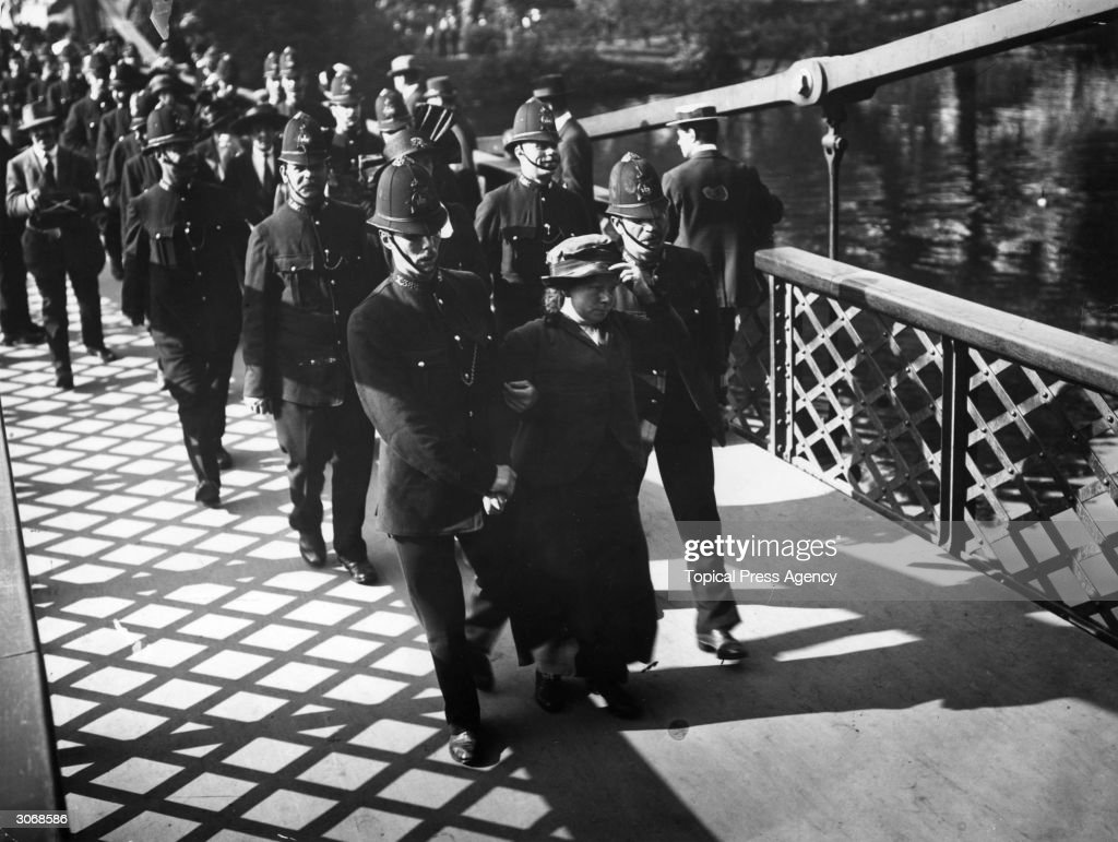 Arrested suffragettes being escorted over the bridge in St James' Park after their attack on Buckingham Palace.
