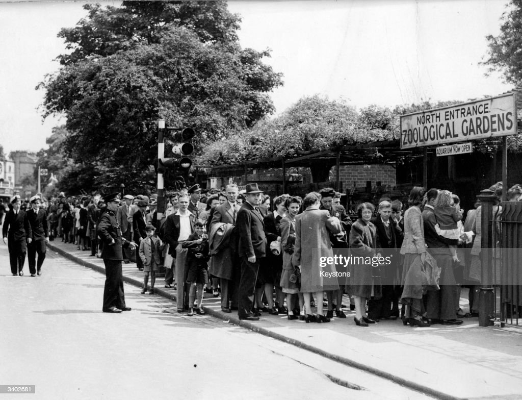 A queue of visitors lining up at the entrance to London Zoo at Regents Park.