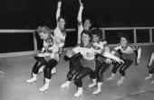 Female members of the US roller skating team practise together at a Harringay rink for the upcoming Roller Derby