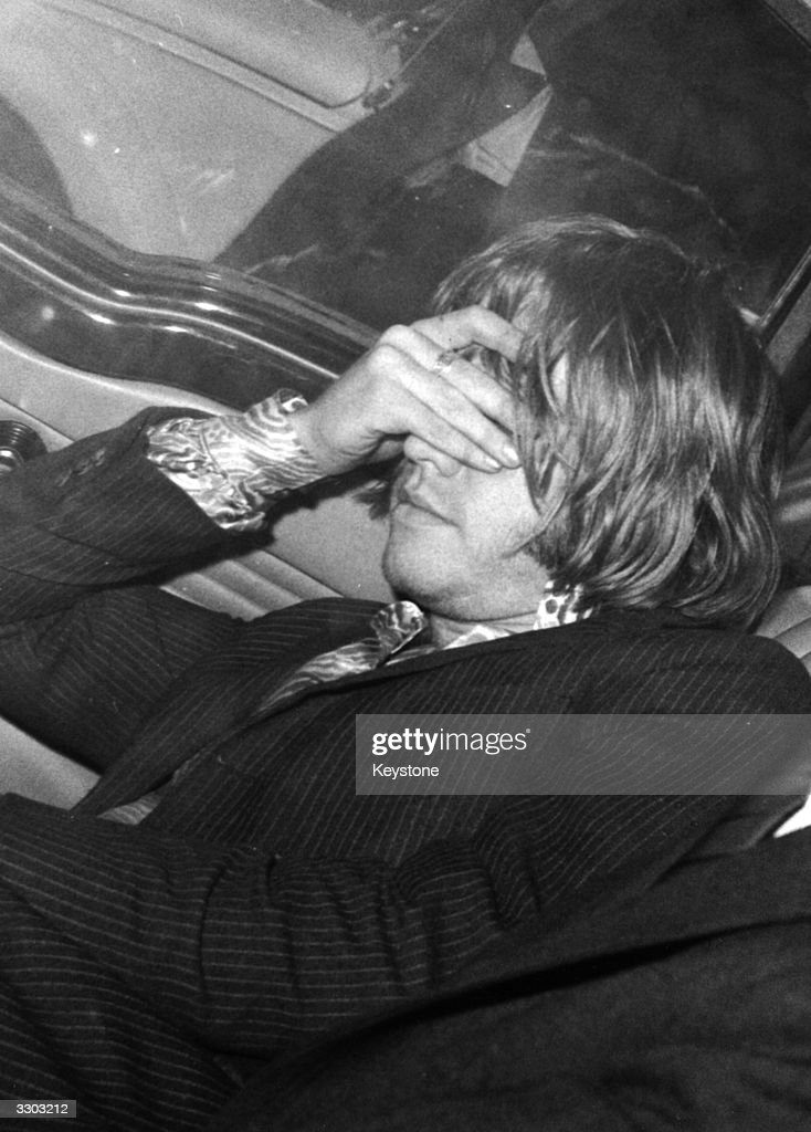 A distraught <a gi-track='captionPersonalityLinkClicked' href=/galleries/search?phrase=Brian+Jones+-+Rolling+Stones&family=editorial&specificpeople=206495 ng-click='$event.stopPropagation()'>Brian Jones</a> (1942 - 1969), guitarist with British pop group The Rolling Stones, after he was arrested at his Chelsea flat, taken to the local police station and charged with possession of cannabis under the Dangerous Drugs Act.