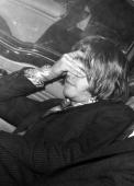 A distraught Brian Jones guitarist with British pop group The Rolling Stones after he was arrested at his Chelsea flat taken to the local police...