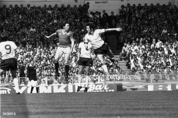 Stuart Pearson jumps up for a header with Jimmy Case during an FA Cup final between Manchester United and Liverpool which United won 21