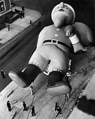Workmen inflating a giant 45foot Santa Claus with helium for the Macy's Parade New York This annual procession is held every Thanksgiving by Macy's...