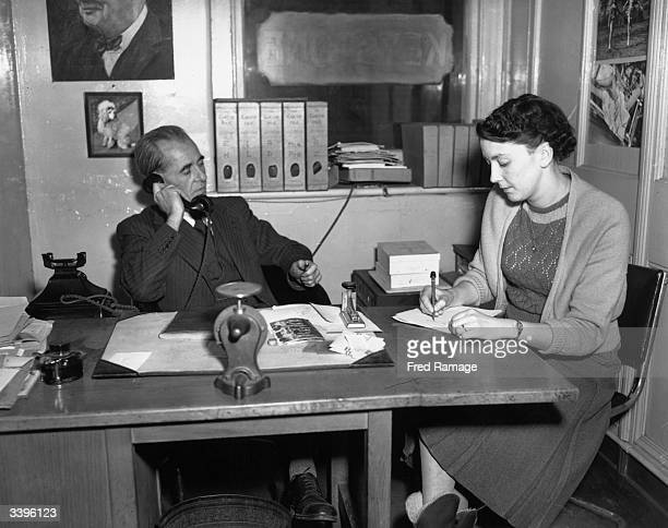 Chief librarian Martin Prince and his secretary at work at Keystone Press Agency