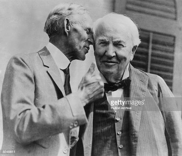 American engineer and inventor Henry Ford whispering to Thomas Alva Edison at the observance of the 50th anniversary of Edison's incandescent light...