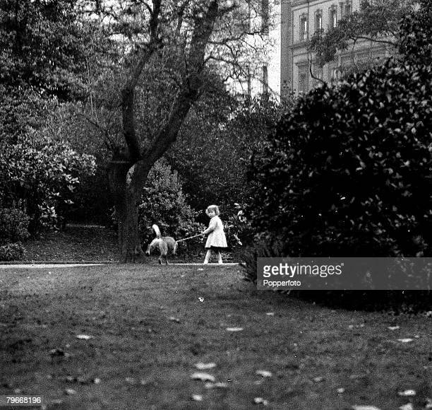 21st October Princess Elizabeth holds onto one of her pet dogs as it spends a penny in one of Londons parks