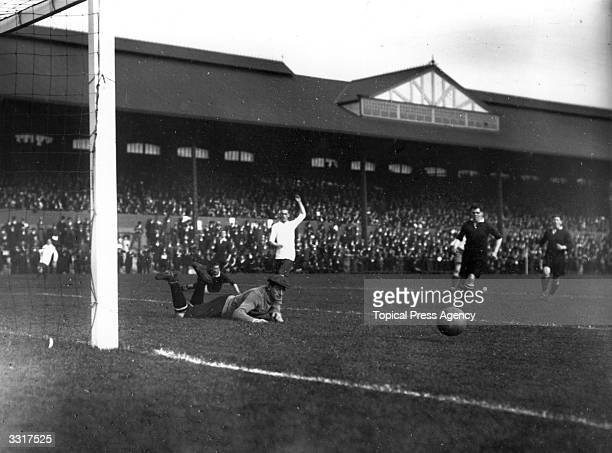 Fulham's goalkeeper pushes the ball from the goalmouth during their match against Bury at Craven Cottage