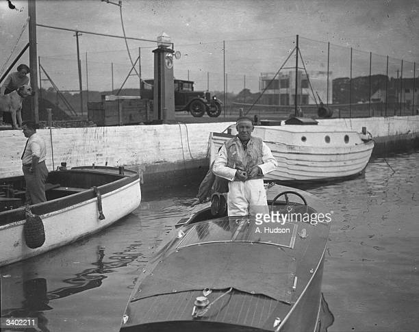 Arthur Bray vicecommodore of the British Motor Yacht Club in his boat after breaking the 24 seamile record in Poole Harbour Dorset with a speed of...