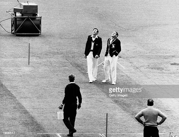 Bill Lawry the Australian Captain and the England Captain Ray Illingworth toss the coin before the forth test in the Ashes series of 197071 at...
