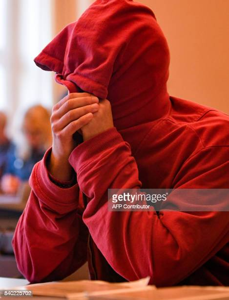 A 21yearold Dutchman sits in court for the first trial over violent riots against the G20 summit in Hamburg northern Germany on August 28 2017 The...