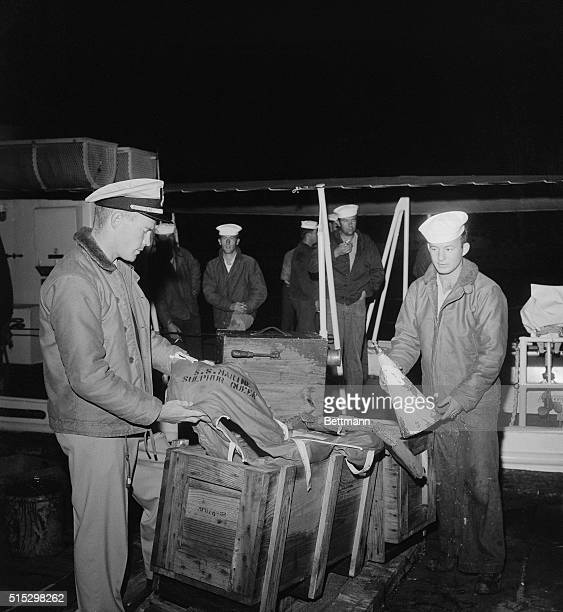 2/21/1963Miami Florida Two life preservers and a foghorn with the name 'SS Marine Sulphur Queen' painted on them are examined by Coast Guardsmen here...
