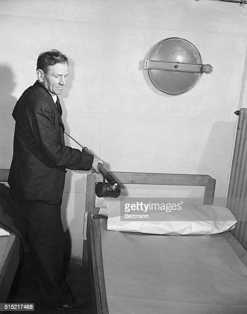 2/2/1946Frankfurt Germany This room in the 'Hotel Kabinen' which was built in an airraid shelter beneath ruined Frankfort gets the DDT treatment...