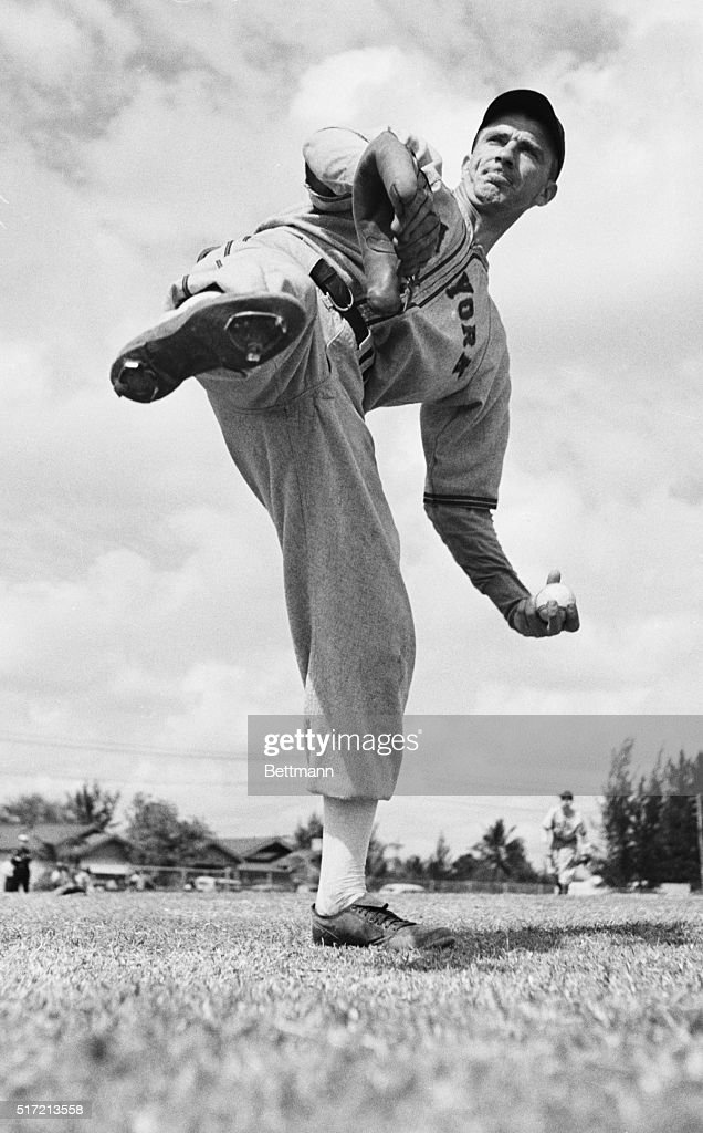 Carl Hubbell, veteran Giant moundsman, gets the old wing in shape for another season of big league campaigning. The hurler is pictured here during a recent practice session at the Giants' training camp.