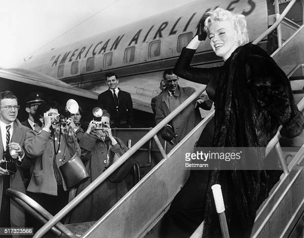2/25/1956New York NY In perfect form as usual Marilyn Monroe obliges Lens Corps at Idlewild as she boards an American Airlines plane for Hollywood