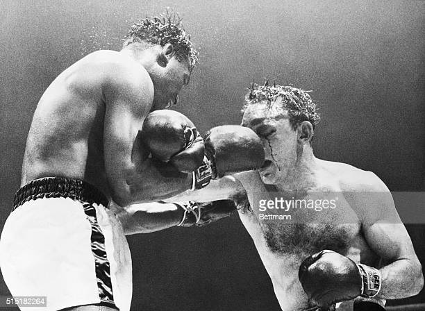 2/25/1958Chicago IL Sugar Ray Robinson comes up with a right to the nose of Carmen Basilio in their middleweight title bout tonight in Chicago...