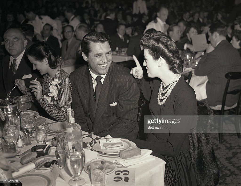 Hollywood, CA-<a gi-track='captionPersonalityLinkClicked' href=/galleries/search?phrase=Cary+Grant&family=editorial&specificpeople=90519 ng-click='$event.stopPropagation()'>Cary Grant</a> and <a gi-track='captionPersonalityLinkClicked' href=/galleries/search?phrase=Rosalind+Russell&family=editorial&specificpeople=206523 ng-click='$event.stopPropagation()'>Rosalind Russell</a> are shown here attending the war crimped awards banquet of the Academy of Motion Picture Arts and Sciences. There were no evening gowns, dress suits, or dancing. Grant saw Joan Fontaine, his co-star of the Alfred Hitchcock picture Suspicion, receive the award for the best female actor of 1941. Brant had been considered for the men's award, which went to Gary Cooper for Sergeant York.