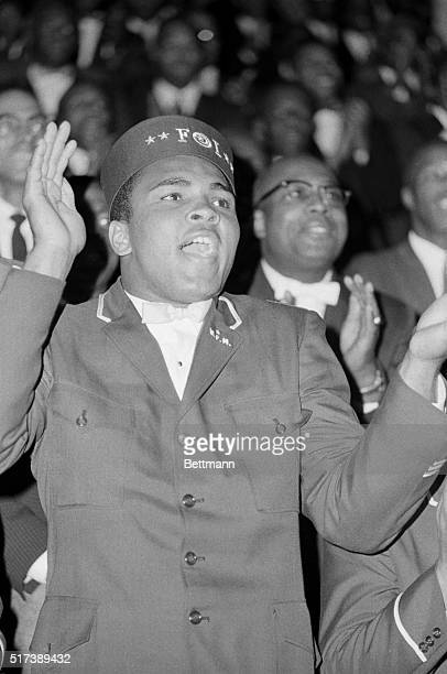 2/27/1966Chicago IL Heavyweight boxing champion Cassius Clay attending a 2day Black Muslim convention shows his emotions during a speech by Elijah...