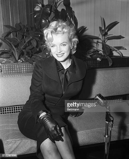 2/28/1956Los Angeles CA Marilyn Monroe is shown as she returned to the film capital Sunday wearing a black suit and mannish type black shirt and tie...