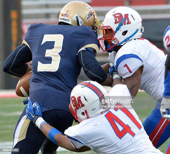 DeMathas Darryl Turner Jr knocked the ball from Good Counsels Keon Paye to cause a fumble in the fourth quarter in the Washington Catholic Athletic...