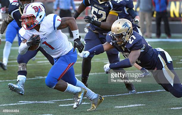 DeMathas Darryl Turner Jr runs for yardage as Good Counsels Jordan Anthony goes for the tackle in the in the third quarter in the Washington Catholic...