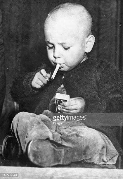 22monthsold boy lights a cigarette in a workmanlike manner According to some information he smokes from time to time a cigarette Los Angeles...