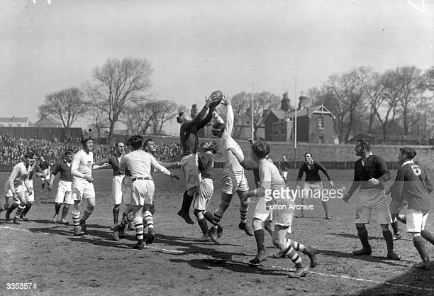 Lt Eyres Captain of the Devonport Services team gets possession from a line out in a match against the USA Olympic Rugby team who won the gold medal...