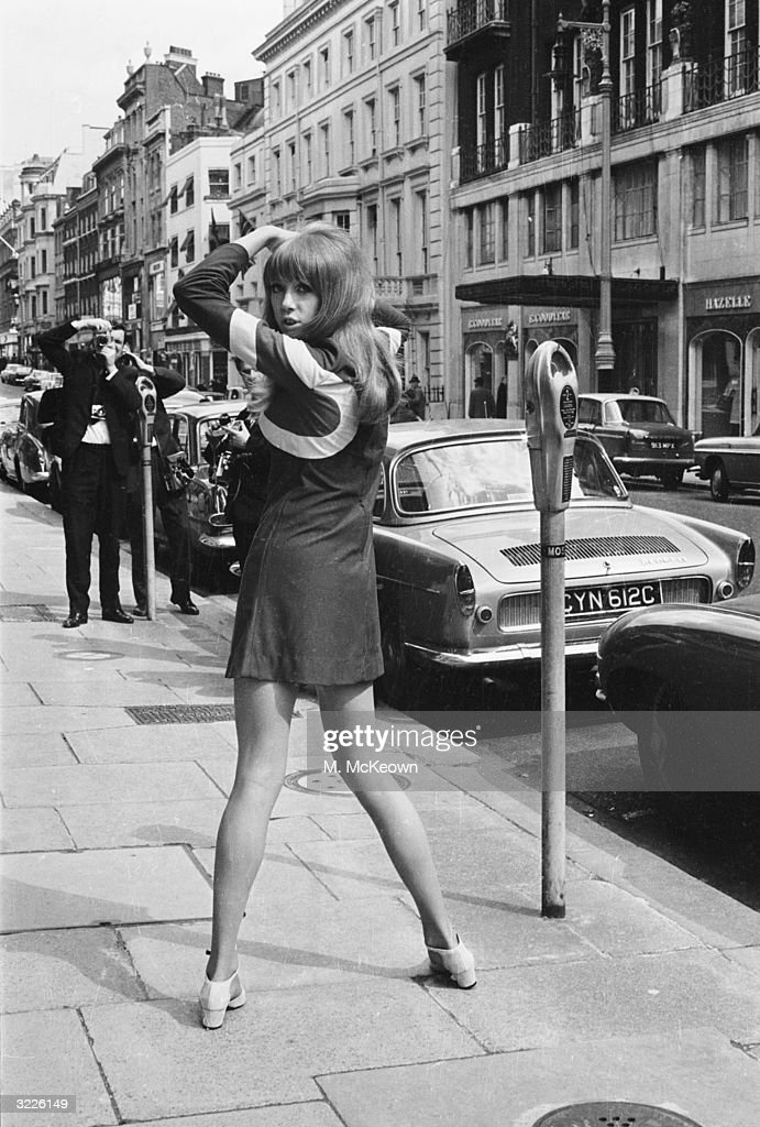 British model Patti Boyd, wife of Beatle <a gi-track='captionPersonalityLinkClicked' href=/galleries/search?phrase=George+Harrison&family=editorial&specificpeople=90945 ng-click='$event.stopPropagation()'>George Harrison</a>, modelling a minidress designed by Quorum in London's Mayfair district.