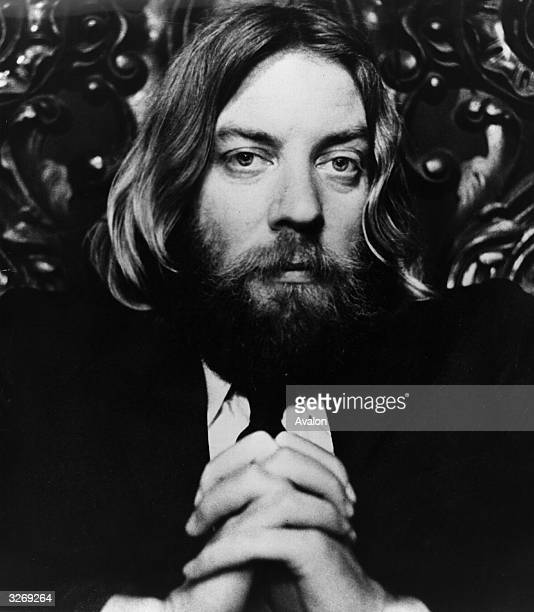 Donald Sutherland playing the shaggybearded longhaired reverend Dupas a hippie Minister of the First Existenial Church in the film 'Little Murders'